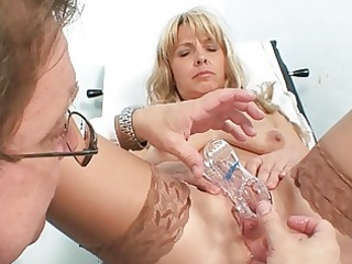 older golden-haired vixen in nylons goes to gyno